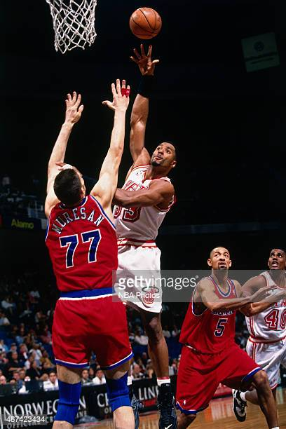 Alonzo Mourning of the Miami Heat shoots against Gheorghe Muresan of the Washington Bullets on March 29 1996 at Miami Arena in Miami Florida NOTE TO...