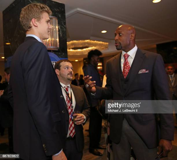 Alonzo Mourning of the Miami Heat talks with NBA Draft prospect Lauri Markkanen during the 2017 NBA Draft Lottery at the New York Hilton in New York...