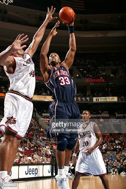 Alonzo Mourning of the New Jersey Nets shoots against Derrick Coleman of the Philadelphia 76ers during the NBA pre-season game October 23, 2003 at...