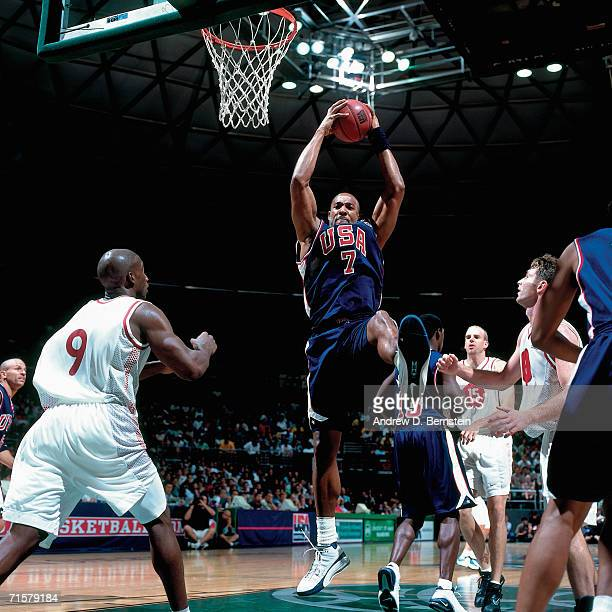 Alonzo Mourning of the United States National Team grabs a rebound against the Canadian National Team during a 2000 pre-Olympic exhibition games on...