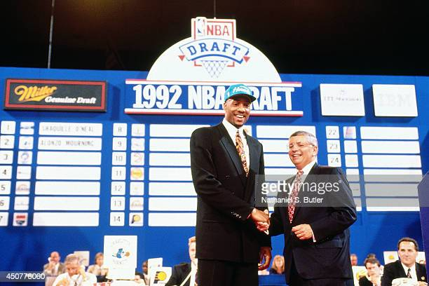 Alonzo Mourning poses for a portrait with NBA commissioner David Stern after being drafted number 2 overall by the Charlotte Hornets at the NBA Draft...