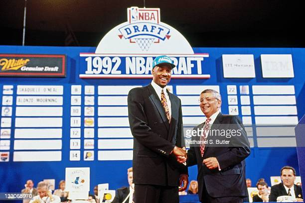 Alonzo Mourning shakes hands with NBA Commissioner David Stern after being selected number two overall by the Charlotte Hornets during the 1992 NBA...