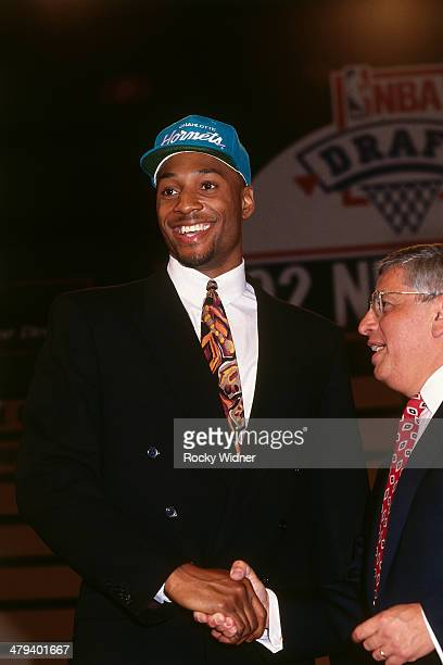 Alonzo Mourning shakes hands with NBA Commissioner David Stern after he was selected number two overall by the Charlotte Hornets during the 1992 NBA...