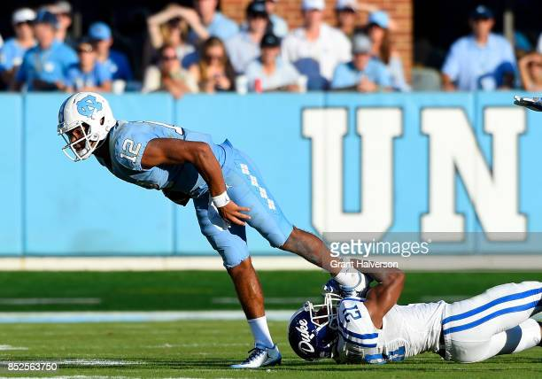 Alonzo Saxton II of the Duke Blue Devils sacks Chazz Surratt of the North Carolina Tar Heels during their game at Kenan Stadium on September 23 2017...