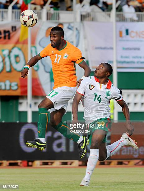 Alo'o Efoulou Paul of Cameroon Lions and Tiene Siaka of Ivory Coast Elephants vie during a friendly match on June 13 at the Houphouet Boigny stadium...