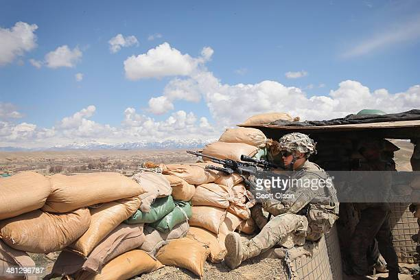 Aloyious Soranno from Fallon Nevada with the US Army's 2nd Battalion 87th Infantry Regiment 3rd Brigade Combat Team 10th Mountain Division keeps...