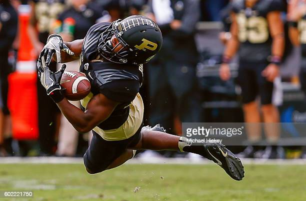 Aloyis Gray of the Purdue Boilermakers attempts to catch the ball that eventually fell incomplete against the Cincinnati Bearcats at RossAde Stadium...