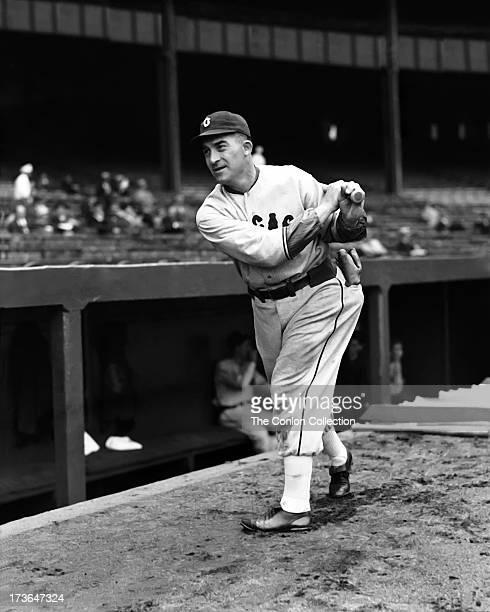 Aloysius H Simmons of the Cincinnati Reds swinging a bat in 1939
