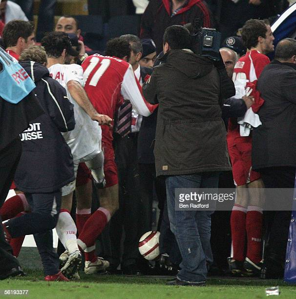 Alpay Ozalan of Turkey aims a kick at Marco Streller of Switzerland as the teams leave the pitch at the end of the FIFA World Cup Playoff, 2nd Leg...