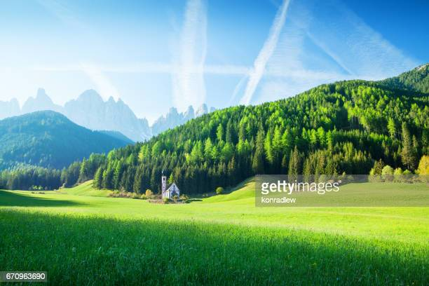 Alpen Landscape - Green field, Village Val di Funes Villnöss and Mountains