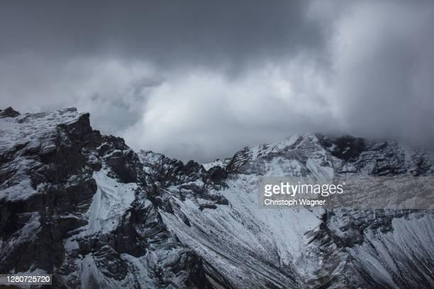 alpen liechtenstein - storm cloud stock pictures, royalty-free photos & images