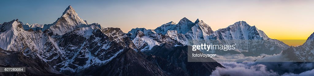 Alpenglow on dramatic mountain peaks panorama Ama Dablam Himalayas Nepal : Stock Photo