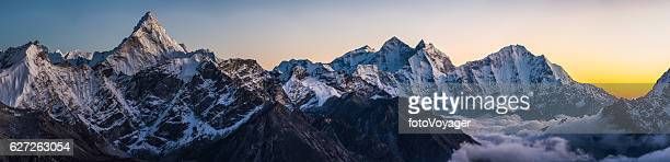 alpenglow on dramatic mountain peaks panorama ama dablam himalayas nepal - mountain range stock pictures, royalty-free photos & images