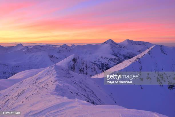 alpenglow sunset over pirin mountain covered in snow - pirin mountains stock pictures, royalty-free photos & images