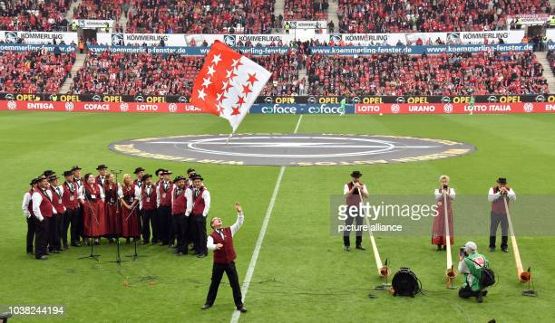 Alpenhorn blowers, the Ahori yodelling club and a flag waver