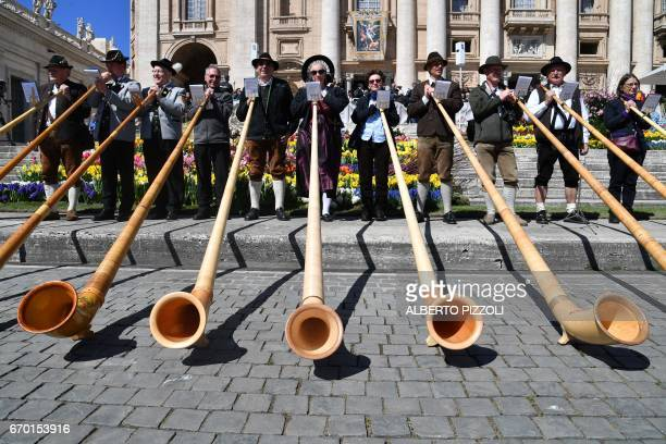 Alpenhorn players from Germany perform on the parvis of St Peter's basilica during Pope Francis' weekly general audience on April 19 2017 at the...