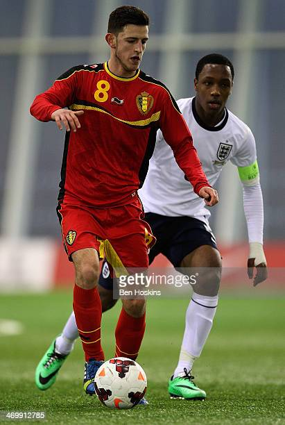 Alper Ademoglu of Belgium holds off pressure from Kaylen Hinds of England during a U16 International match between England and Belgium at St Georges...