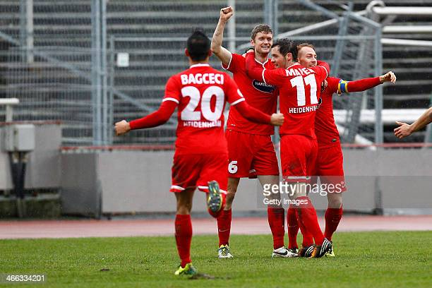 Alper Bagceci, Tim Goehlert, Patrick Mayer and Marc Schnatterer of Heidenheim celebrate a goal during the Third league match between Borussia...