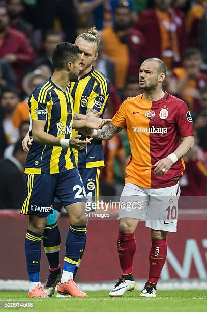 Alper Potuk of Fenerbahce and Wesley Sneijder of Galatasaray having a discussion during the Super Lig match between Galatasaray and Fenerbahce on...
