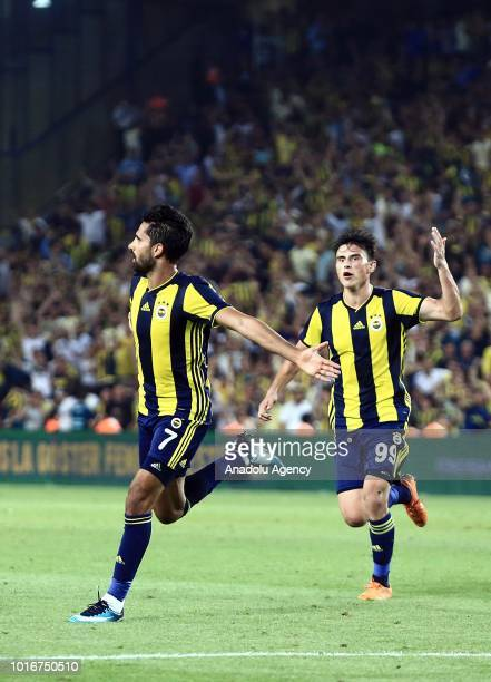 Alper Potuk of Fenerbahce celebrates his goal with his teammate Eljif Elmas during UEFA Champions League third qualifying round's second leg match...