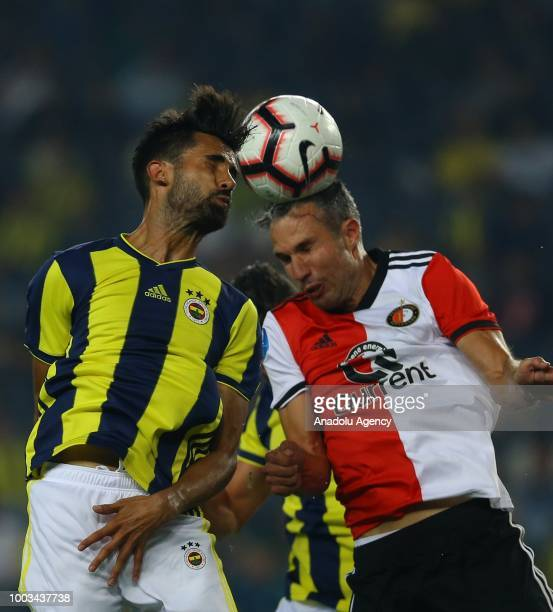 Alper Potuk of Fenerbahce in action against Robin Van Persie of Feyenoord during a friendly match between Fenerbahce and Feyenoord at the Ulker...