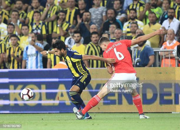 Alper Potuk of Fenerbahce in action against Ruben Dias of Benfica during UEFA Champions League third qualifying round's second leg match between...