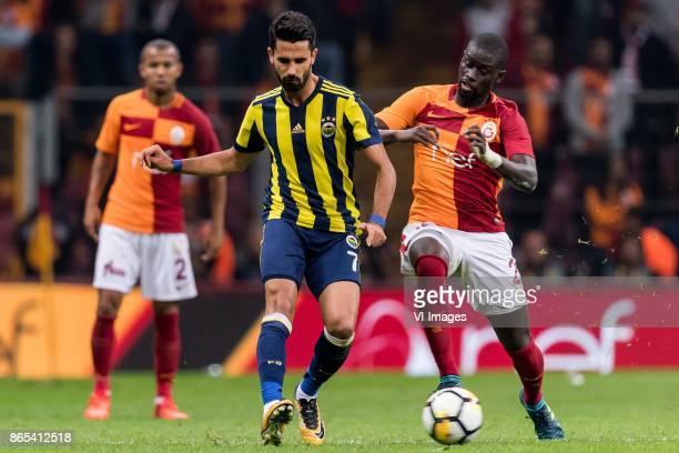 Alper Potuk of Fenerbahce SK Papa Alioune N'Diaye of Galatasaray SK during the Turkish Spor Toto Super Lig football match between Galatasaray SK and...