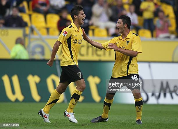 Alper Uludag of Aachen celebrates the second goal with Tolgay Arslan during the Derby Cup 2010 match between Alemannia Aachen and Bayer Leverkusen at...