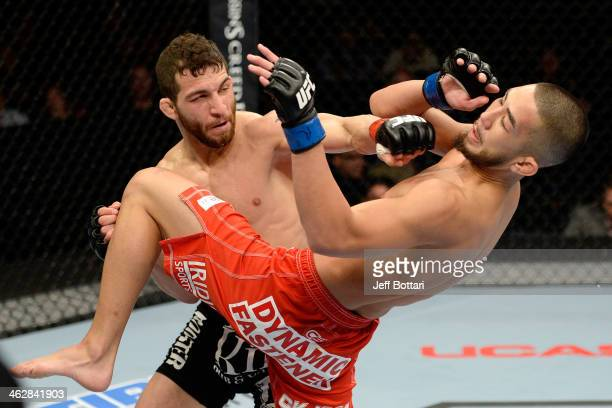 Alpetkin Ozkilic punches Louis Smolka in their featherweight fight during the UFC Fight Night event inside The Arena at Gwinnett Center on January 15...