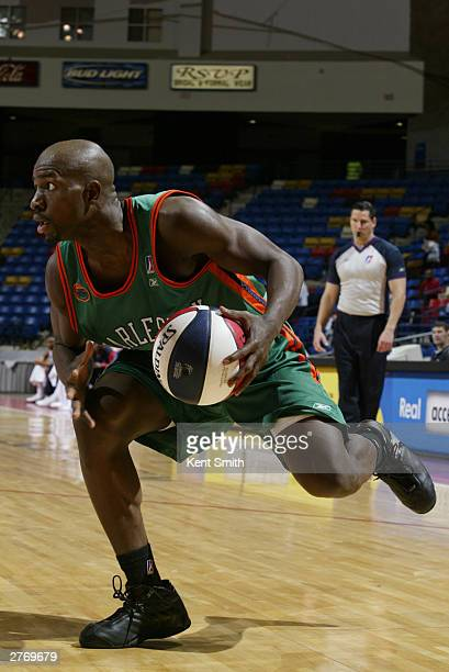 Alpha Bangura of the Charleston Lowgators drives to the basket against the Fayetteville Patriots at the Crown Coliseum November 29 2003 in North...