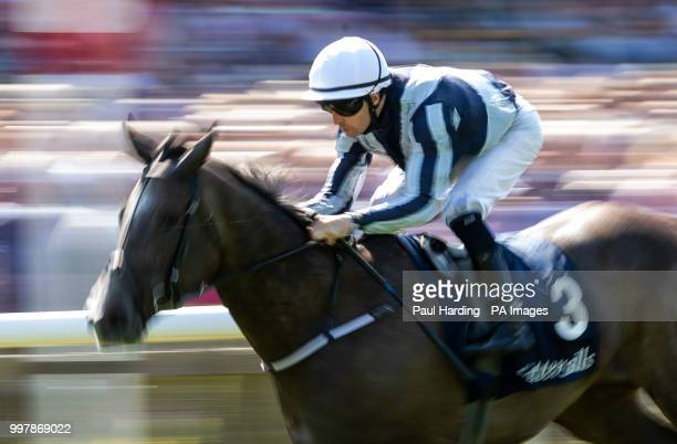 Alpha Centauri ridden by Colm O'Donoghue wins The Tattersalls Falmouth Stakes during day two of The Moet Chandon July Festival at Newmarket Racecourse