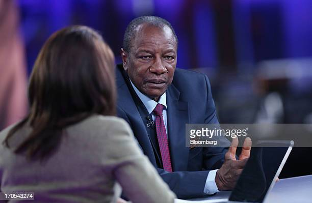 Alpha Conde Guinea's president right pauses during a Bloomberg Television interview in London UK on Friday June 14 2013 Guinea's $51 billion economy...