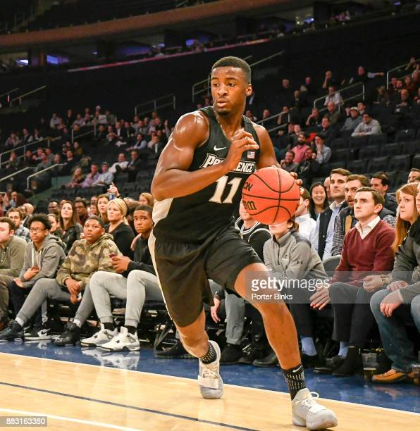 Alpha Diallo of the Providence Friars dribbles during a game against the Washington Huskies in the 2K Classic at Madison Square Garden on November 16...