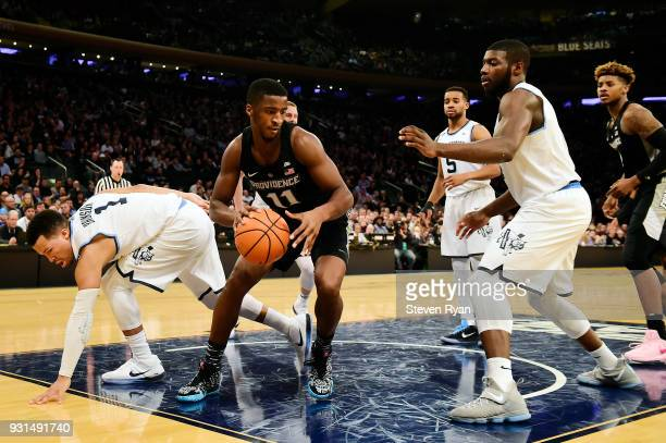 Alpha Diallo of the Providence Friars handles the ball on offense against the Villanova Wildcats during the championship game of the Big East...