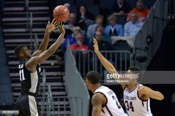 Alpha Diallo of the Providence Friars puts up a shot over Tyler Davis of the Texas AM Aggies in the first round of the 2018 NCAA Men's Basketball...