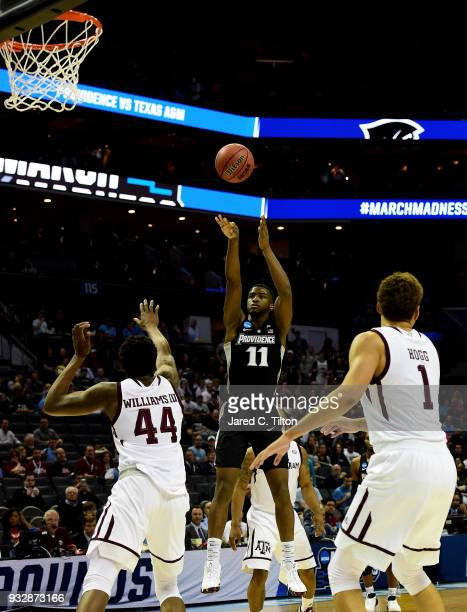 Alpha Diallo of the Providence Friars shoots over Robert Williams of the Texas AM Aggies during the first round of the 2018 NCAA Men's Basketball...