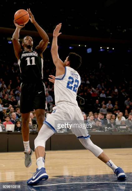 Alpha Diallo of the Providence Friars takes a shot against Kaiser Gates of the Xavier Musketeers in the first half during semifinals of the Big East...