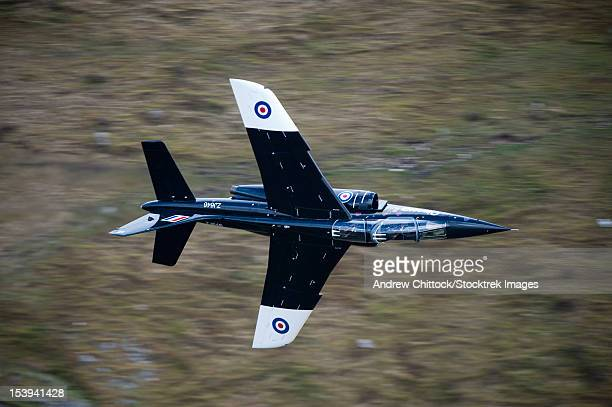 Alpha Jet of the Royal Air Force low level flying in the mach loop, North Wales, United Kingdom.