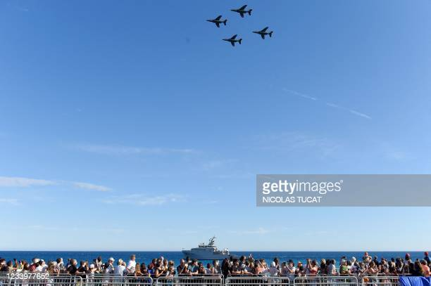 Alpha jets of the French Air Force fly over the Promenade des Anglais during a military ceremony to mark the Bastille day in the French coastal city...