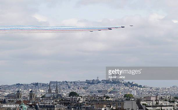 Alpha Jets of the French Air Force La Patrouille de France releasing trails of blue white and red smoke the colors of the French national flag fly...