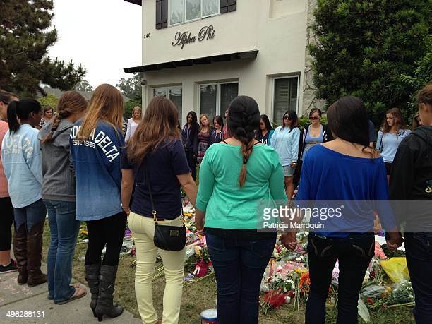 Alpha Phi sorority women gather today for an impromptu service in honor of the two women slain in the Isla Vista massacre