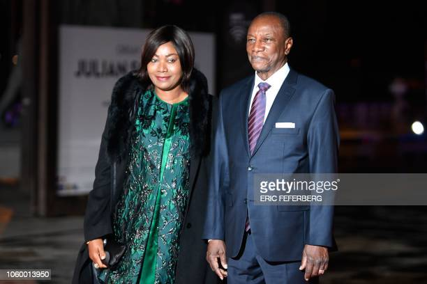 Alpha Republic of Guinea's President Alpha Conde and his wife Djene Kaba arrive at the Musee d'Orsay in Paris on November 10 2018 to attend a state...