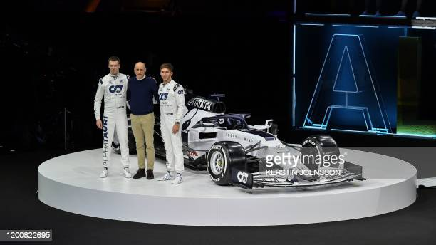 Alpha Tauri's Russian driver Daniil Kvyat and Alpha Tauri's French driver Pierre Gasly pose with Austrian Teamchef Franz Tost in front of the new car...