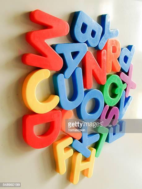 Alphabet and Language Magnets