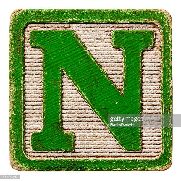 alphabet - antique block letters, isolated on white. letter n. - letter n stock pictures, royalty-free photos & images