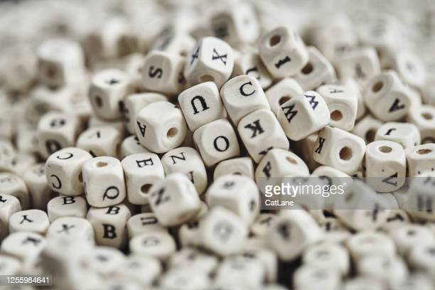 alphabet beads background - spelling stock pictures, royalty-free photos & images