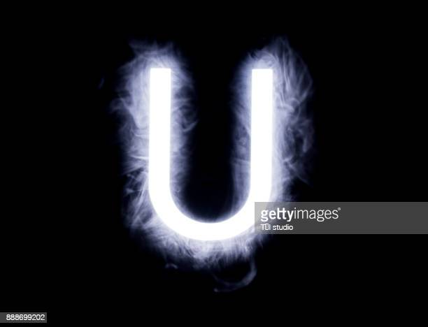 alphabet black background - letter u stock photos and pictures