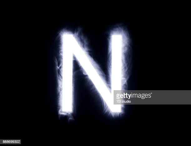 alphabet black background - letter n stock pictures, royalty-free photos & images