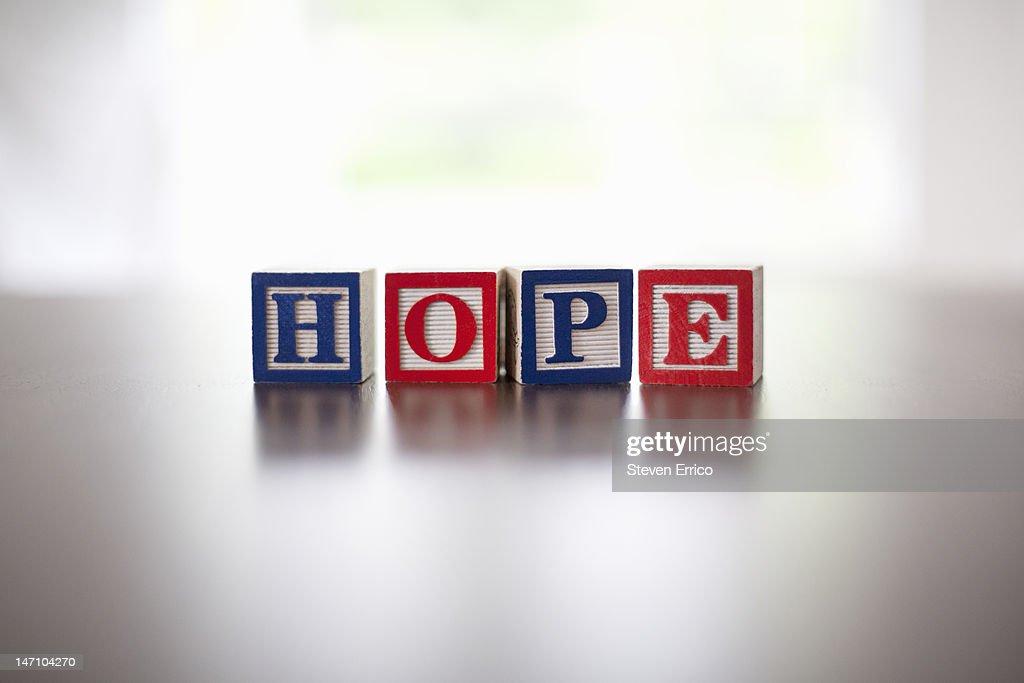 Alphabet blocks spelling the word 'hope' : Stock Photo