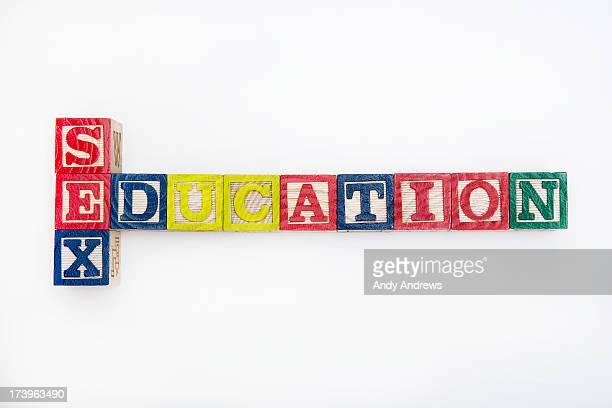 Alphabet building blocks spell sex and education